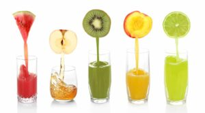 juice-pouring-fruits-into-glass
